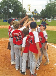 Photo Submitted/  The Lincoln American All-Stars hoist their district championship trophy after defeating Walthall 10-3 in game three of the series.