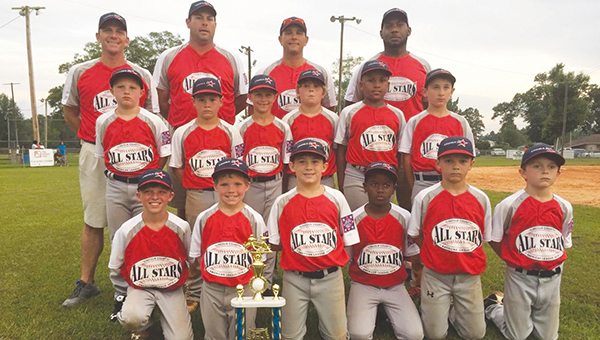 Photos Submitted/  The 8-year-old Lincoln American All-Stars smile with their trophy after a victory in game three over Walthall. Members of the team are Glenn Lewis, Seth DeGeorge, Carter Palmer, D.J. Washington, Wilson Calcote, Cole Spencer, Dawson White, Graham Smith, Ladarious Jackson, Bram Wolfe, Walker Brady and Casen Easterling.  The Americans head coach is Shane Easterling. Assistant coaches are Colby Calcote, Jaymie Palmer and Durrell Washington.