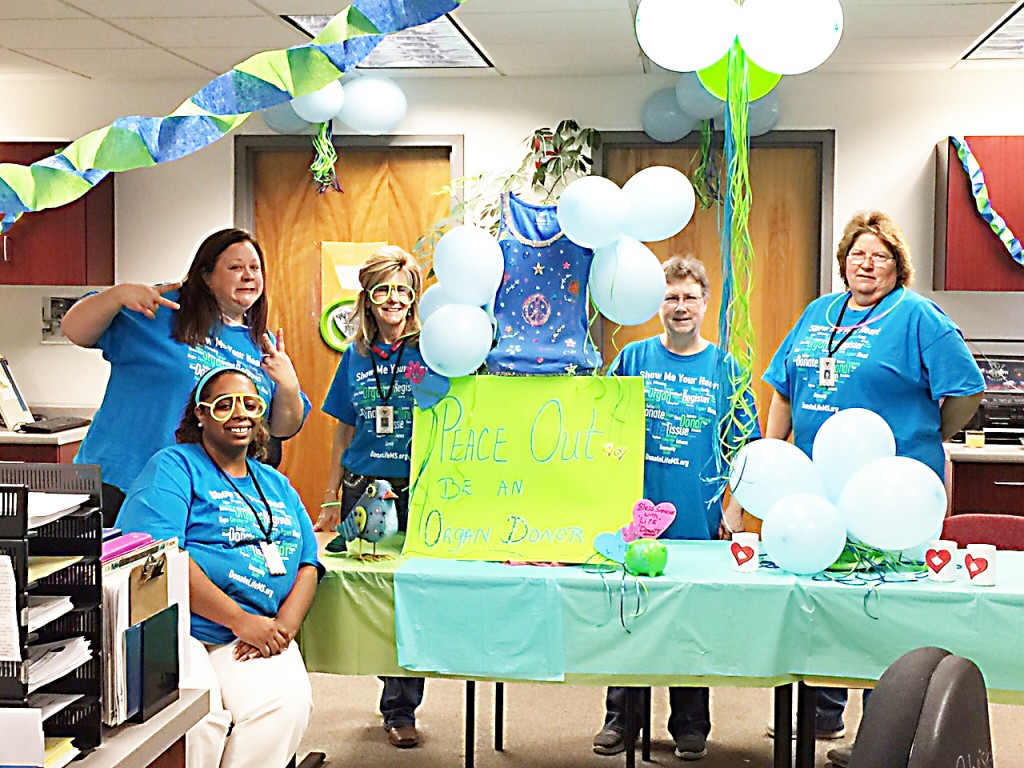 Photo submitted  /The Brookhaven Department of Public Safety's driver's license office won the Red Heart award last week during the Mississippi Organ Recovery Agency's third annual Spero Awards. Tonya Jones (left) Cynthia Phillips, Christine Cloy, Lucye Moore and Paula Smith are shown in the Brookhaven office, which they decorated for Blue and Green Day in April during National Donate Life Month. Not pictured are Elaine Gardner and Betty Berry.