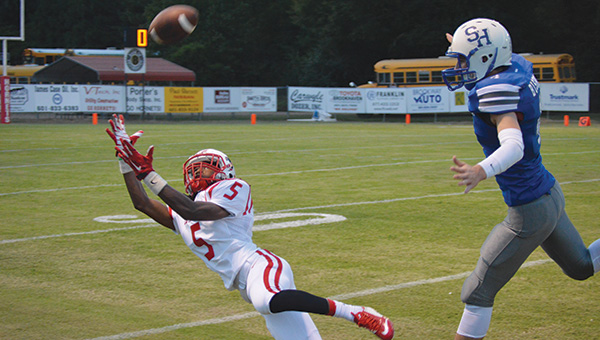 File photo/ PrimeTime 23 sophomore wide receiver James Beard stretches out to reel in a catch during a game last season.