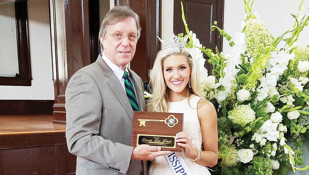 Photos by Donna Campbell/Brookhaven Mayor Joe Cox presented Miss Mississippi Laura Lee Lewis with a key to the city during a homecoming reception in her honor Saturday at Mary Jane Lampton Auditorium. This was Lewis's first official visit back to her hometown since winning the crown in June. She's been busy preparing for the Miss American pageant, which will be held in Atlantic City in September.