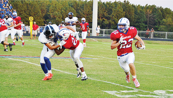 Photo courtesy of Copiah County Courier/   PrimeTime 23 running back Landon Murphy turns up the field looking for extra yardage during a game last sesaon.