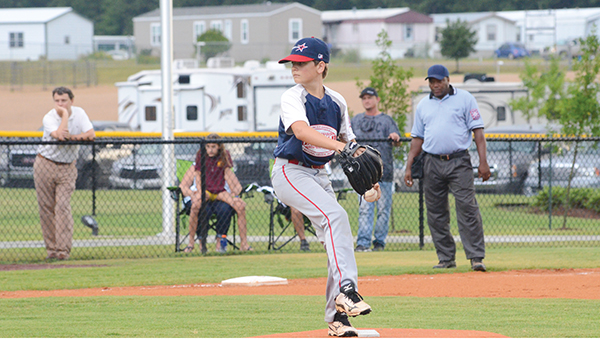 Photo  by Anthony McDougle/ Judson Griffin delivers a pitch during the Lincoln Nationals game against the Pike Americans Wednesday at the Lincoln Civic Center Baseball Complex.