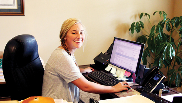 Photo by Alex Jacks/Incoming Loyd Star senior Pollyanna Patterson works for Pamela C. Stamps' CPA office on Jackson Street and believes there are numerous benefits to students having summer jobs.