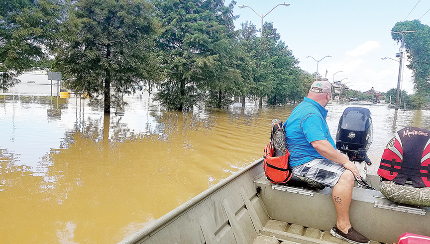 Photo submitted/Daryl Harveston, of Brookhaven, runs his boat along I-12 in Denham Springs Monday, headed toward the Bass Pro Shop. Harveston and several other members of the Brookhaven Moose Family Center helped rescue flood victims in Louisiana earlier this week. See more pictures at www.dailyleader.com.