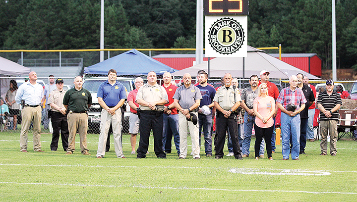 Photo by Amy Rhoads/Members of law enforcement, military and volunteer firefighters were honored Friday night at Loyd Star's first game of the season.