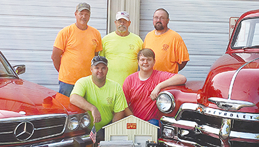 """Submitted photo/Volunteers at the New Sight Fire Department are ready for the annual """"Smoking Tires and Putting Out Fires"""" car show and festival Saturday. Showing off a handcarved replica of their new pumper is President Don Smith (back row, left), firefighter Roger Hill, Vice President Warren Allen; Chief Cory Smith (front row) and car show chairman Austin Smith. Funds from the festival will help pay for the pumper the VFD purchased in March."""