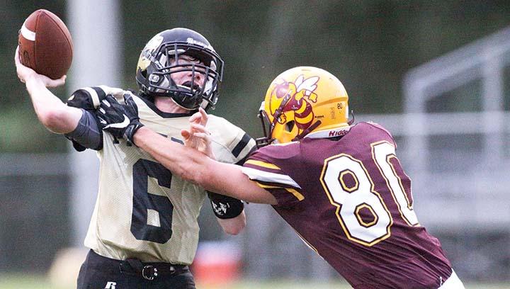Photo  by Jonathon Alford/  Enterprise's Drake Allen tries to bring down Ethel's quarterback .