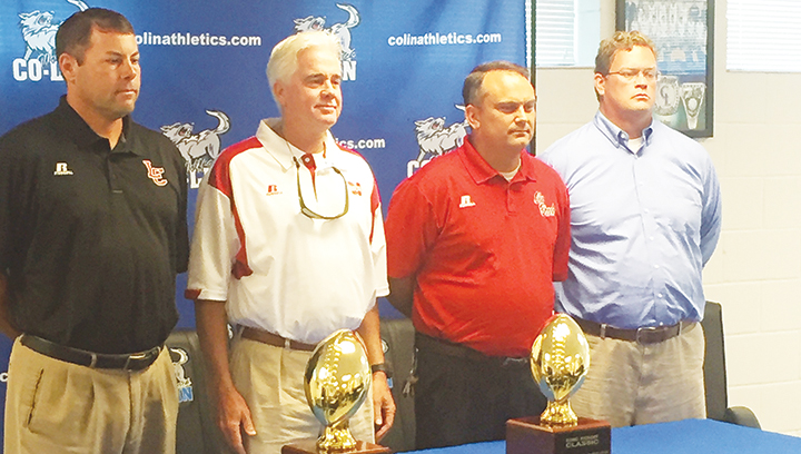 Photo by Anthony McDougle/  Lawrence County head coach Jaymie Palmer (left), Magee head coach Tim Coats, Ole Brook's head coach  Tommy Clopton and  first-year Franklin County head coach Trey Woodard stand with the trophies that will be awarded to the winners of the first inaugural KDMC Kickoff Classic during a press conference  Wednesday.