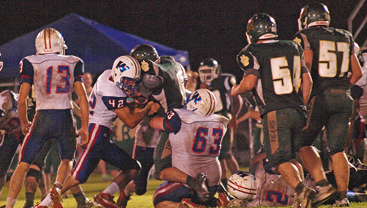 Photo by Tracy Fischer/ Wesson's Blake Runyan (No. 42) and Joseph Carraway wrap up McLaurin's Christian Tindoll.
