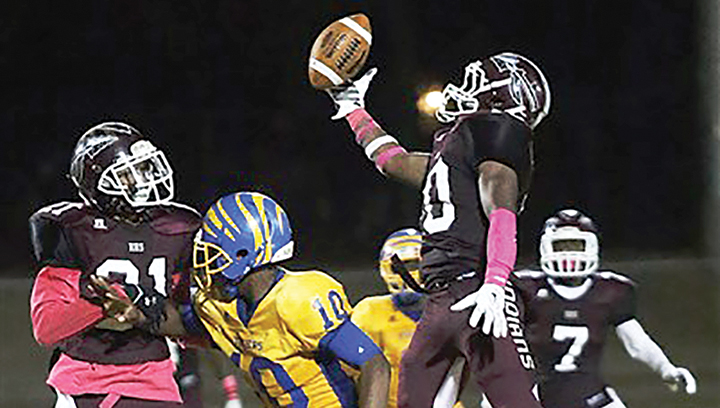 Photo by Jimmy Crockett / Hazlehurst middle linebacker Tim Steward goes up to grab a one-handed interception.