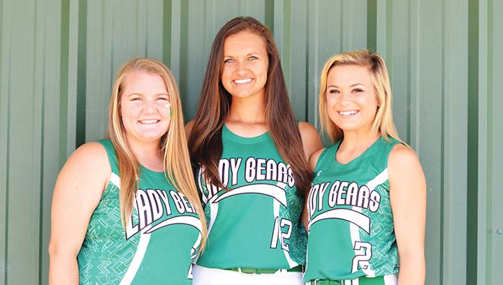 Photo by Anthony McDougle/  Anna Brooke Davis (left), Makennah Redd and Sara Jane Doty are seniors on West Lincoln's slow-pitch softball team.