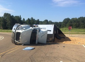 A woodchip truck overturned on Hwy. 84 westbound into Silver Creek today about 9:10 a.m.