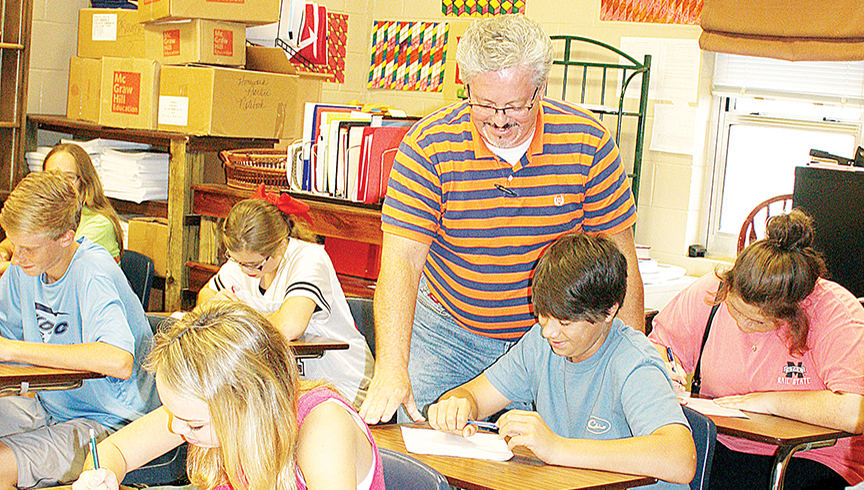 Photos submitted/Stacey Smith goes over a math lesson with one of his classes at Loyd Star Attendance Center.