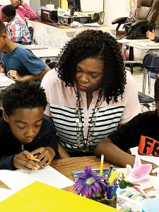 Bridgette Gilmore teaches a lesson to Joe Love at Brookhaven Elementary School recently.