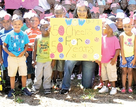 Photo by Aaron Paden/Children aged 3 and 4 at the Lindsey Head Start Center constructed headbands and posters in celebration of Mississippi Action for Progress's 50th anniversary. The organization educates children in low-income families in preparation for kindergarten.
