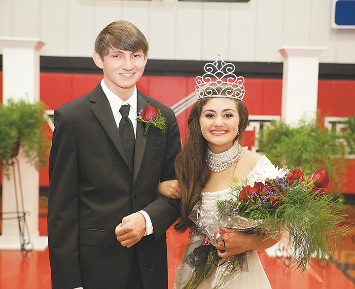 Photo by Amy Rhoads/Jered Cade (left) escorts Loyd Star's 2016 Homecoming Queen Courtney Wyant. Wyant was crowned queen Friday at Loyd Star Attendance Center prior to the school's football game against Scott Central.