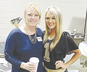 Brookhaven Animal Rescue League volunteer Deana Pendley (left) visits with Saintsation Summer Rials with the New Orleans Saints at last year's celebrity dinner. Rials was a special guest at the 2015 event.