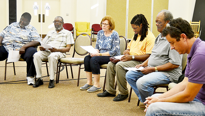 Photo by Donna Campbell/Betty Harrington with the Lincoln County Chapter of Mission Mississippi (center) leads a prayer during one of the sessions in the three-hour focused prayer time held Tuesday at First United Methodist Church's Ministry Center. Prayers were offered specifically for unity, children and youth and law enforcement officers. Besides this special time of prayer, the chapter hosts monthly meetings at various churches throughout the county. The next will be Oct. 25 at St. James M.B. Church, 949 E. Monticello St., at 5:15 p.m.