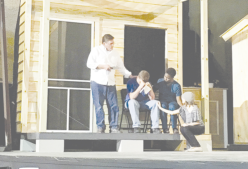 "Photo submitted/Larry Baker (left) practices a scene from the Brookhaven Little Theatre's production of Harper Lee's ""To Kill a Mockingbird"" with Gage Beard, Zetonnia Ferguson and  Cadence Laird. Tickets for the play start at $15. All of the actors were recently practicing for the upcoming play."