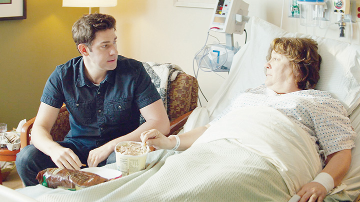 "Photo courtesy of Sony Pictures Classic/John Krasinski (left), who stars as John Hollar in the movie ""The Hollars,"" sits with Margo Martindale , who portrays Sally Hollar, in a King's Daughters Medical Center hospital room during a scene shot in 2014."