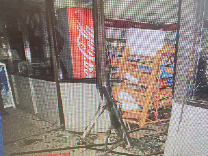 Photo submitted/Suspects used a stolen F-250 to smash into the wall of the C Store on Hwy. 51 Sept. 20 to steal an ATM. Police are looking for Gregory Trigg and Thaddeus Jarvis in connection with the crime. The truck was found on fire at the Jehovah's Witnesses Kingdom Hall nearby not long after the theft was reported.