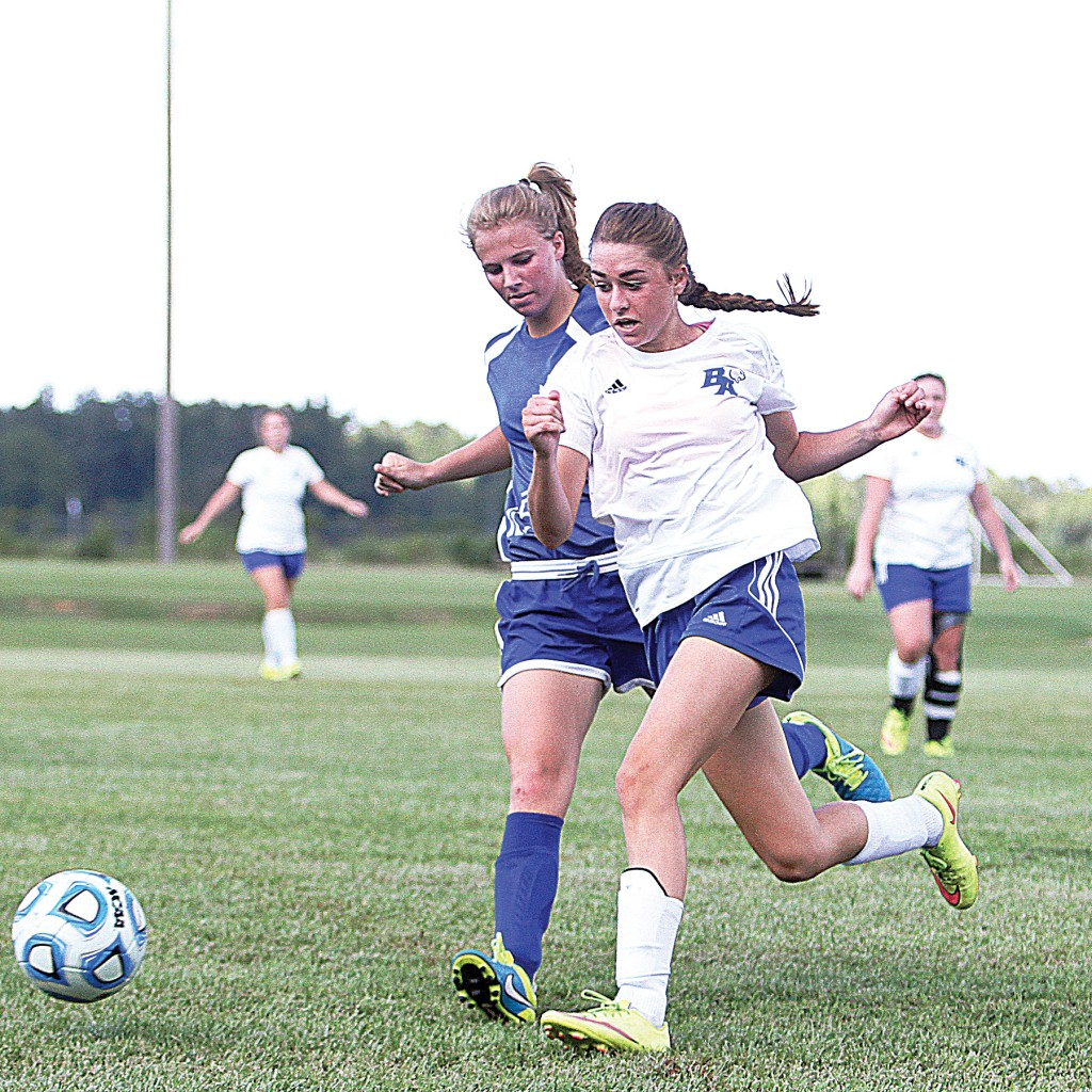 Photo by Sherylyn Evans /BA's Madalyn Oglesby and Adams County Christian's Bailey Boyd fight for possession in the Cougars' 2-1 loss at home to the Rebels Wednesday night.