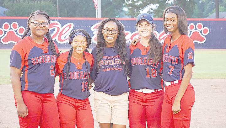 Photo submitted /The Brookhaven Panthers slow-pitch softball team honored its seniors during a doubleheader against North Pike Monday night. Senior members of the team are (from left) Jada Henderson, Tia Bussey, team manager Takia Brooks, Macy Ziskin and Cheyenne Motley.  Each senior received a rose and  gifts from the booster club as well as family members and teammates.  Each player also had two members of the team recite a short speech about them.