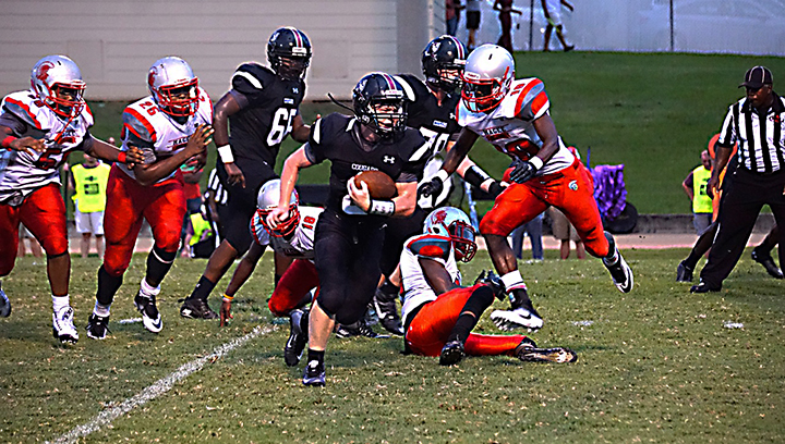 Photo by Jana Harp/ Lawrence County running back Brandon Bullock looks for room in the Cougars' first game of the season against the Magee Trojans.