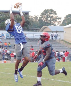 Photo by Anthony McDougle /Co-Lin wide receiver DeAndre Barnes goes up for a catch in the first quarter of a win over MS Delta Thursday night at Stone Stadium.