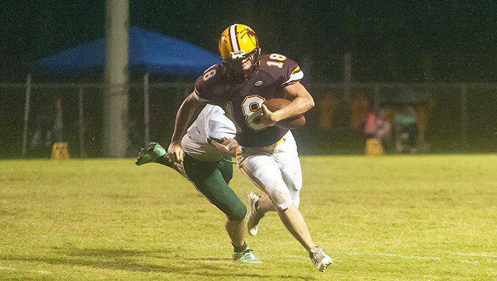Photo by Teresa Allred/ Enterprise's Brady Williams tries to shake off a McLaurin defender in the Yellow Jackets' homecoming game against the Tigers Friday night.