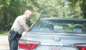 Photo by Alex Jacks/Lincoln County sheriff's deputy Ian Smith makes a traffic stop while patrolling the county Friday.