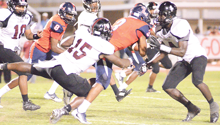 Photo  by Anthony McDougle/  Ole Brook running back Kenneth Dixon is wrapped up by Lawrence County's Marcus Atterberry during the two team's game Friday night at King Field in Brookhaven.