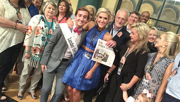 Photo submitted/Miss Mississippi Laura Lee Lewis poses with a recent edition of The Daily Leader newspaper as she's surrounded by family and friends who made the trip to Atlantic City to watch her compete in the Miss America pageant tonight.