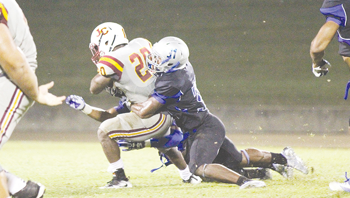Photo by Amy Rhoads /JCJC running back Scott Phillips is wrapped up by Co-Lin defensive back Jaquarius Landrews in the Wolves' win at home against the Bobcats Thursday.