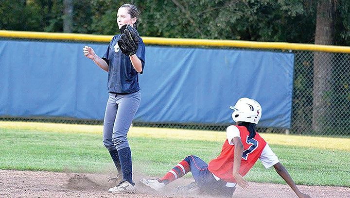 Photo submitted/Ole Brook's Cheyenne Motley slides into second base as the Bobcats' second baseman Karly Leake awaits the throw during their game Tuesday night.