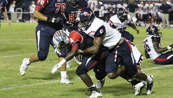 Photo courtesy of Laurel-Leader Call/ Ole Brook defensive back Jemaurian Jones wraps up a South Jones runner during their game Friday night.
