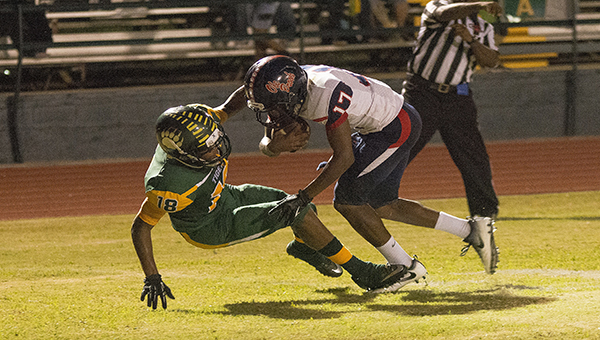 Photo by Rick Wells/  Ole Brook Sevante Quinn tries to get past a McComb defender in the Panthers'  41-14 victory Friday.