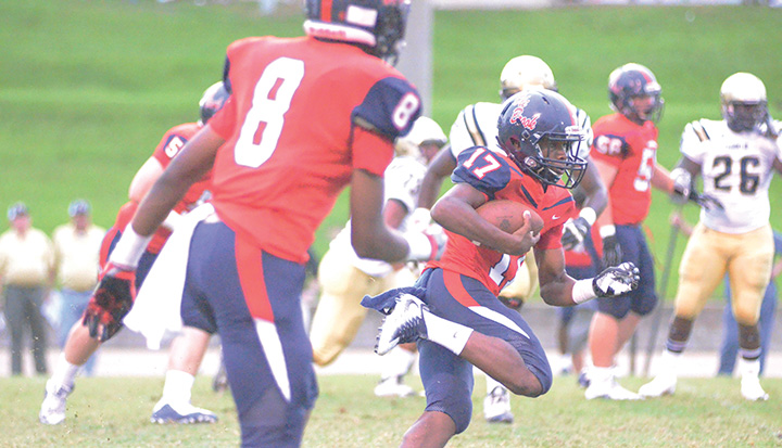Photo  by Anthony McDougle /Ole Brook quarterback Sevante Quinn looks for running room against the Franklin County Bulldogs.