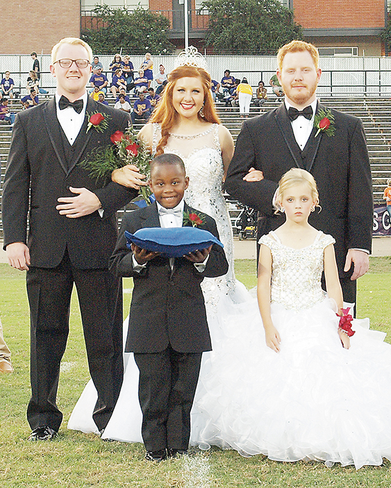 Photo submitted.Lacie Tarver, the daughter of Lisa Tarver and the late John Tarver, of Wesson, was crowned Wesson Attendance Center's 2016 Homecoming Queen Friday night. She was escorted by her brothers, Jacob Tarver (left) and Blake Tarver, and accompanied by Micah Thomas and Ady Rose Dowd.