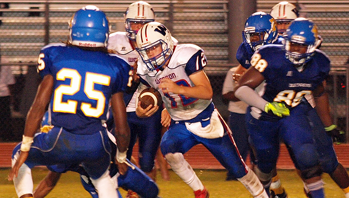 Photo by Tracy Fischer/ Quarterback Peyton Burns looks for running room in Wesson's 33-32 overtime victory against Raymond Friday night.