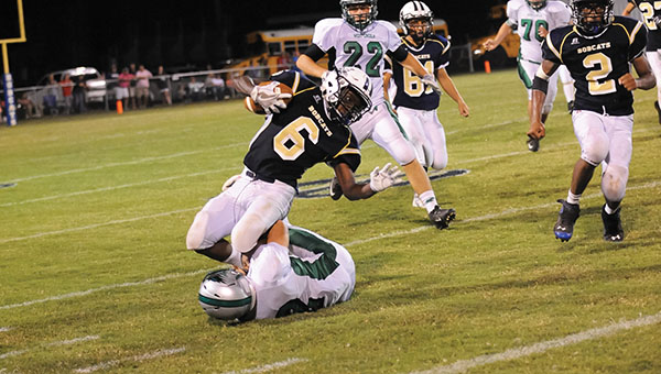 Photo  by Teresa Allred/  Bogue Chitto running back Terrance Morgan is wrapped up by a West Lincoln defender in the Bobcats 40-6 loss to the Bears Friday night.