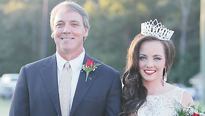 Photo by Sherylyn Evans/Sophie Love Wilson, daughter of Jeff and Missy Wilson and escorted by her father, was crowned the 2016 Brookhaven Academy Homecoming Queen Friday night.
