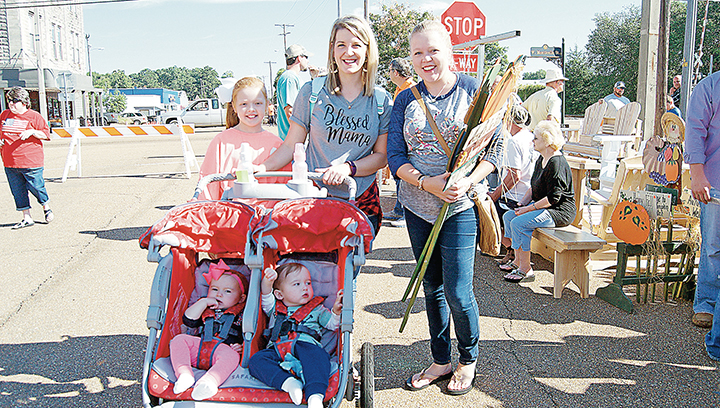 Photos by Donna Campbell/The 42nd annual Ole Brook Festival drew huge crowds to downtown Brookhaven Saturday including Laney Leggett (left), Ashley Leggett and Jenny Leggett with Anna Lauren and Sam Leggett in the stroller. The festival boasted a record turnout with thousands of people enjoying the two-day event. Activities included entertainment Friday night and again on Saturday, a 5K cancer walk, car show, kids' zone, food vendors and plenty of arts, crafts and specialty booths.
