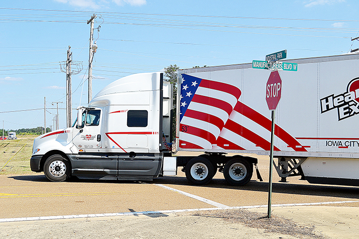 Photo by Donna Campbell/An 18-wheeler turns onto Manufacturers Boulevard West off Industrial Park Road to enter the Brookhaven Industrial Park Monday. The Lincoln County Board of Supervisors Monday chose Dungan Engineering to manage a $2.7 million repaving project to rebuild and repair Manufacturers Boulevard East and West and Fender Trail.
