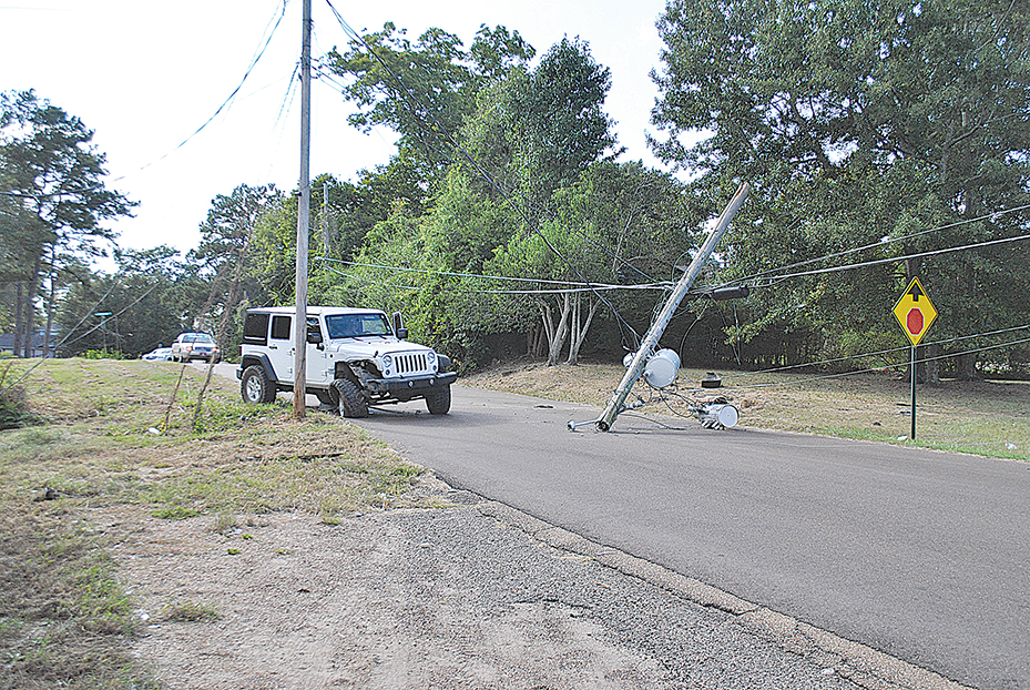 Photo by Aaron Paden/Caleb Owens ran his Jeep into a utility pole around 4 p.m. Tuesday on West Congress Street. Brookhaven Police responded to the crash.
