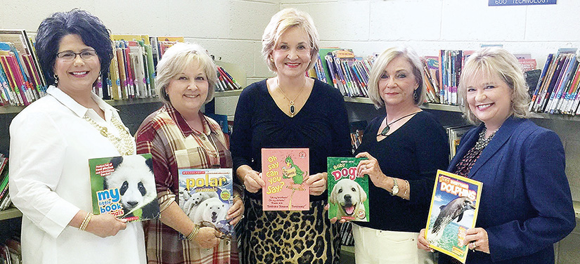 Photo submitted/Lincoln County Republican Women members Cindy Moore, Jennifer Whittier, Karen Sullivan, Patsy Yates and Becky Currie gather for a photo to commemorate their new annual book drive at the Mamie Martin Library recently.