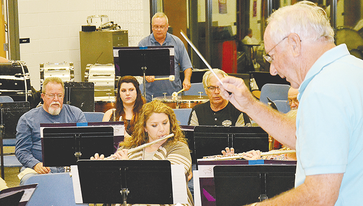 Photo by Donna Campbell/Leroy Smith leads members of the Ole Brook Wind Symphony at a recent practice. The group of area musicians will perform a free concert Tuesday at 7 p.m. at Easthaven Baptist Church.