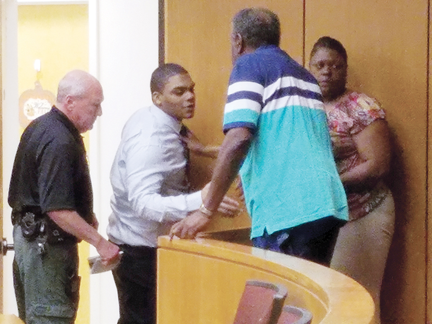 Photo by Donna Campbell/Chance Smith (second to left) spends a few minutes with members of his family Thursday after he pleaded guilty to aggravated assault on a law enforcement officer.
