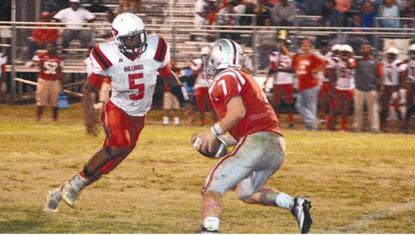 Photo by Lydia King/  Parker Flowers looks for running room Friday against Prentiss.